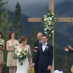 bride and groom standing at altar on mountainside